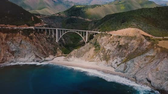 Thumbnail for Epic Cinematic Aerial Shot of Famous Bixby Creek Bridge on Highway Summer Landscape Panorama in