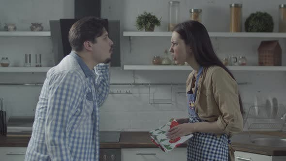 Thumbnail for Couple Scolding in Kitchen with Smashing Plates
