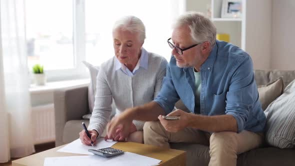 Thumbnail for Senior Couple with Money and Bills at Home 89