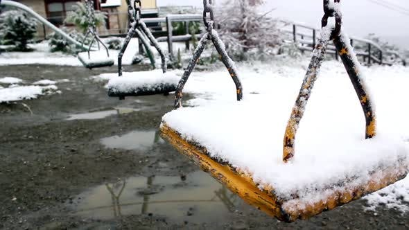 Thumbnail for Empty Swing In Winter Time Covered With Snow.
