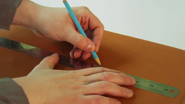 A Shoemaker Makes a Pattern for Boots Made of Genuine Leather. Use a Pencil and Ruler To Draw a