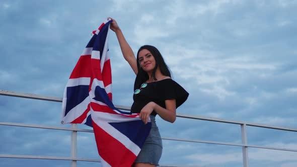 Girl holding the United Kingdom flag