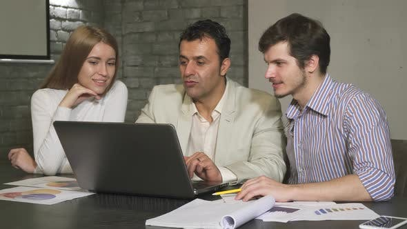 Thumbnail for Hispanic Mature Businessman Helping His Employees During Business Meeting
