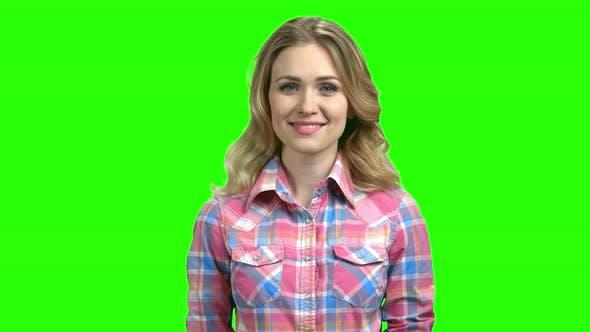 Young Woman in Checkered Shirt Looking at Camera
