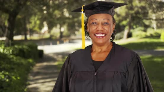 Thumbnail for An older black woman graduating college