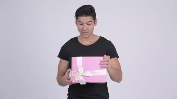 Thumbnail for Young Happy Multi-ethnic Man Opening Gift Box and Looking Surprised