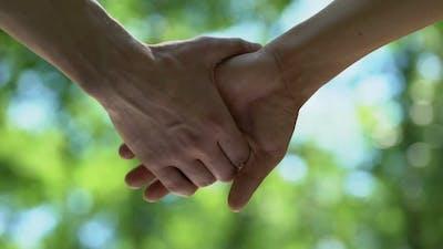 Man Letting Partners Hand Go, Homosexual Couple Break Up, Misunderstanding