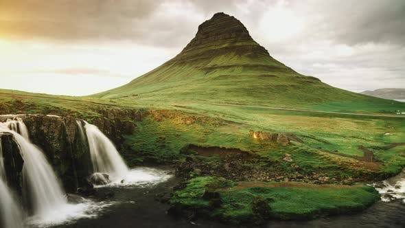 Cover Image for Waterfall Cascades And Mountain At Sunset Light In Western Region Iceland