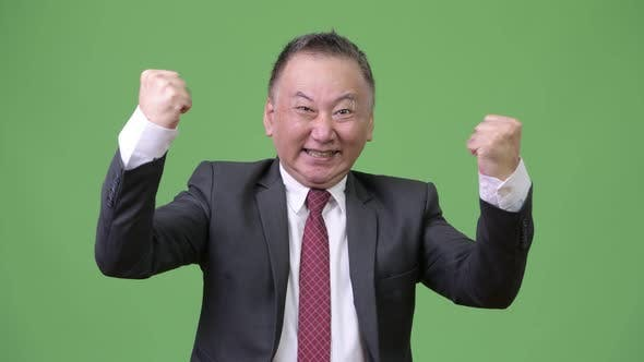 Thumbnail for Mature Happy Japanese Businessman Smiling and Feeling Excited