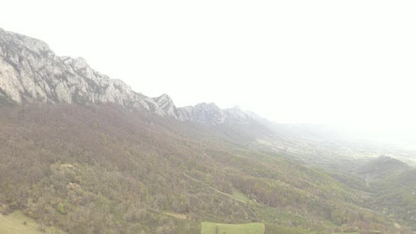 Veliki Krsh mountain in Eastern Serbia under fog 4K drone footage