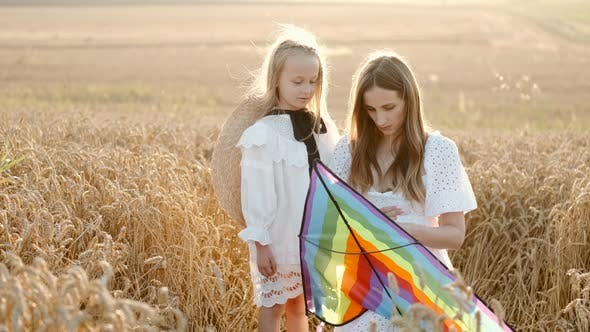 A Mother and Daughter Preparing To Fly a Kite