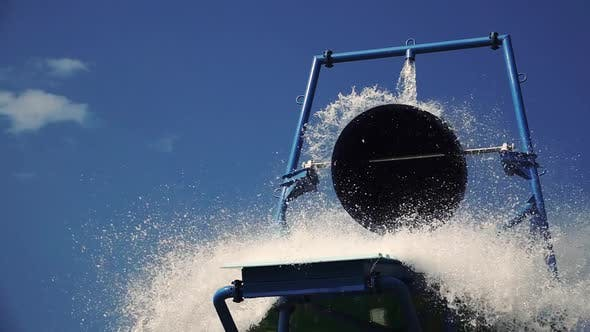 Thumbnail for Amusement Park Poured Water From the Bucket on the Hill. Slow Motion. Close Up