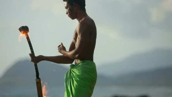 Thumbnail for Hawaiian fire knife dancer performs