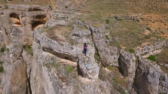 Thumbnail for Girl Standing On Edge Of Cliff