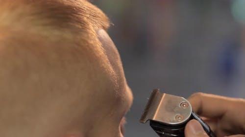Man Hairdresser Making Hair Edging of His Client
