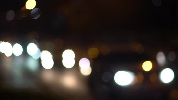 Thumbnail for Defocus Cars Driving on the Night Highway with Lights