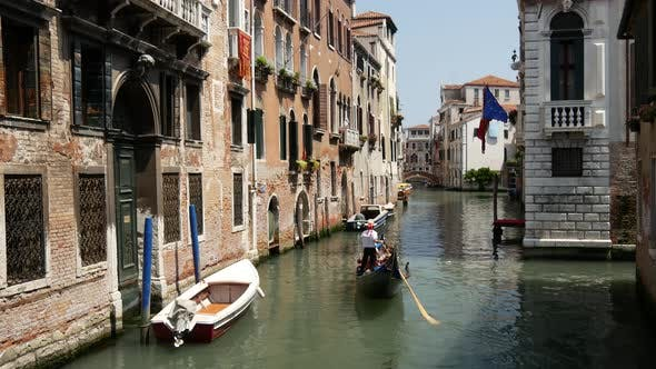 Thumbnail for Gondola in a canal and Venetian flag in Venice