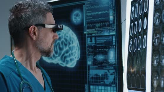Doctor Examining Brain Scan with VR Headset