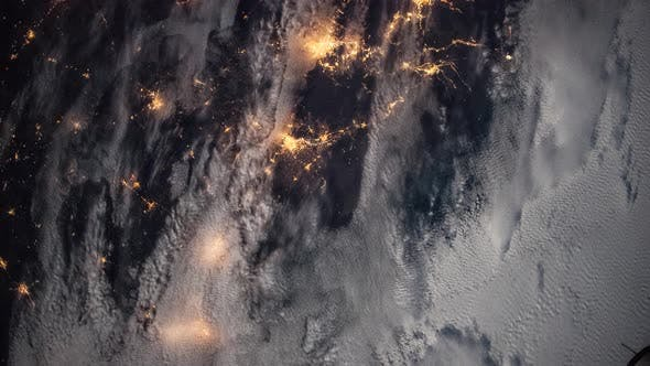 Thumbnail for Glowing Cities at Night Seen From Space Station