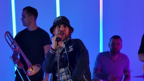 Concert Rock Band Performing Ska Punk Reggae with Singer Performer Trombone and Drummer