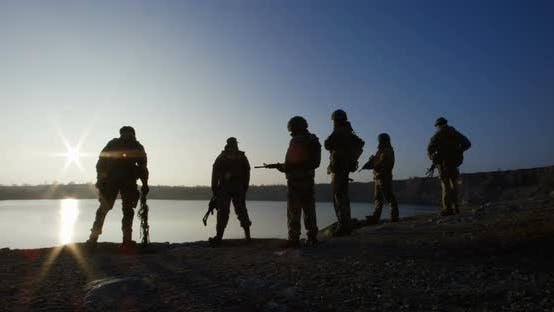 Thumbnail for Equipped and Armed Soldiers at a Lake