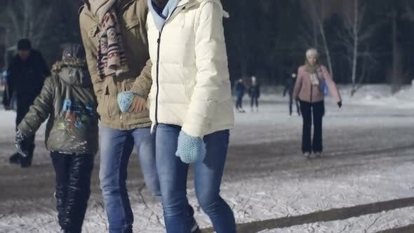 Thumbnail for Couple Skating on Ice Rink in Evening
