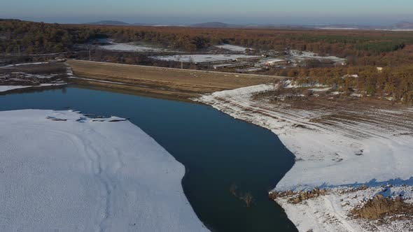 Thumbnail for Flight Over A Dam On A Snowy Winter Day