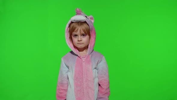 Thumbnail for Little Blonde Child Girl Smiling Putting on Unicorn Costume Pajamas on Chroma Key Slow Motion