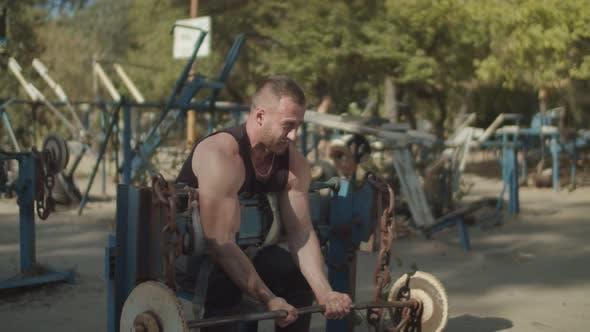 Thumbnail for Stromg Bodybuilder Performing Barbell Biceps Curls