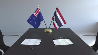 Flags of New Zealand and Thailand on the Table