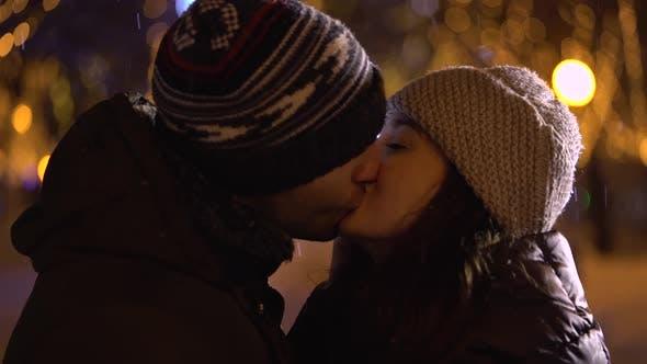 Thumbnail for Man Hugging and Kissing Girlfriend at Night