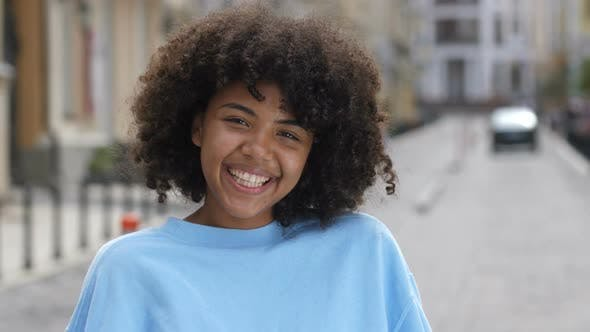 Thumbnail for Outdoor Portrait of Laughing Curly Mixed Race Girl
