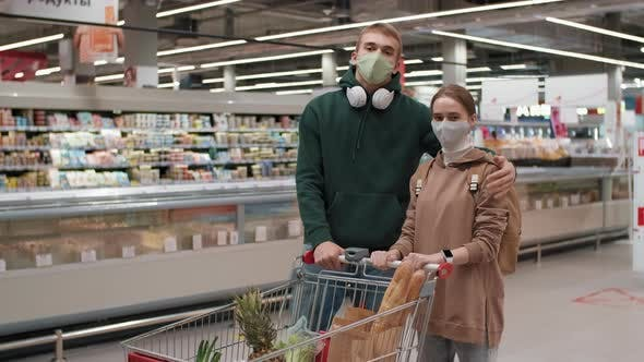 Portrait Of Young Couple In Supermarket