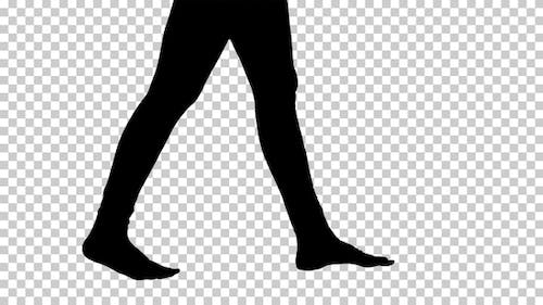 Silhouette Womans legs are bare and taking steps Yoga