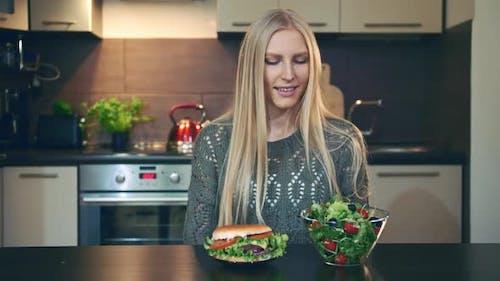 Young Lady Preferring Hamburger To Salad.