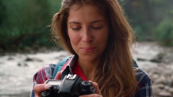 Hiker Using Photo Camera During Hike