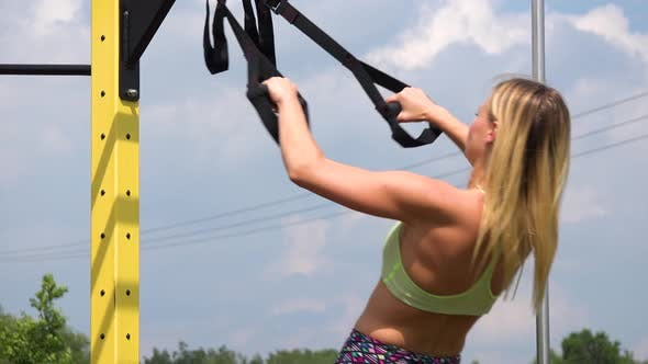 Thumbnail for A Fit Woman Does Inclined Pull-ups at an Outdoor Gym - Closeup