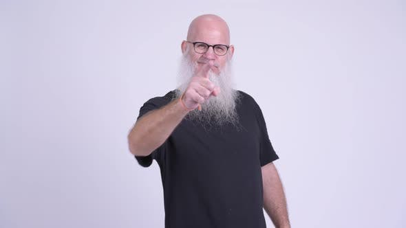 Thumbnail for Angry Mature Bald Bearded Man Pointing To Camera