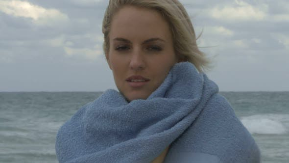 Thumbnail for Female wrapping a towel around her on a beach