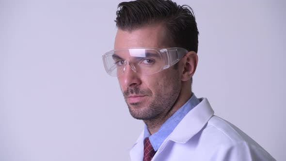 Thumbnail for Profile View of Young Happy Hispanic Man Doctor Wearing Protective Glasses