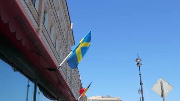 The Small Swedish Flag is Fluttering in the Wind