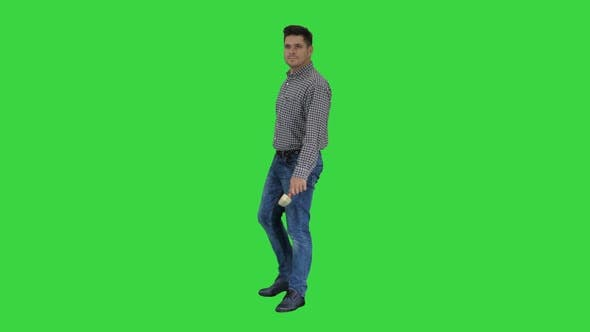 Thumbnail for Casual Man with Brush and Some Liquid Looking What To Paint and Smiling To Camera on a Green Screen