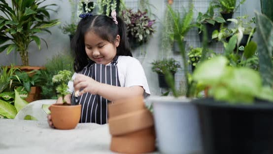 Girl checking a soil