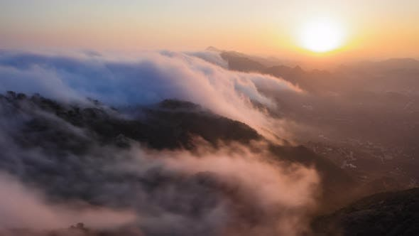 Cover Image for Aerial Time Lapse of Sunset and Cloud Waterfall Above the Mountains in Malibu