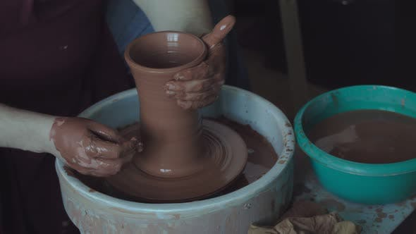 Thumbnail for Potter Working on Clay Jug