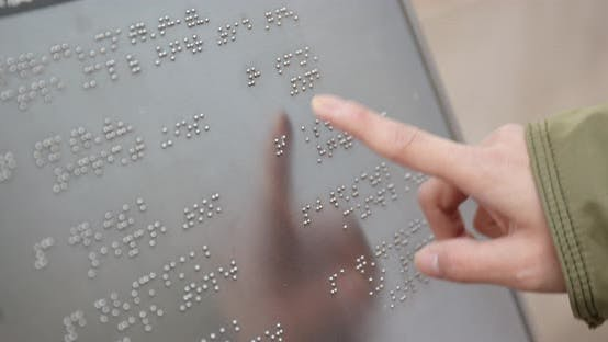Thumbnail for Blind reading on Braille at outdoor