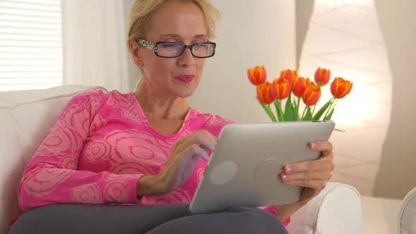 Thumbnail for Mature woman using tablet computer