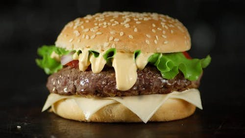 The Burger with Vegetables and Beef Slowly Rotates