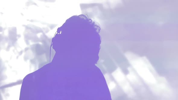 Thumbnail for Night Club Atmosphere. DJ Silhouette Performing Music at Mixing Console