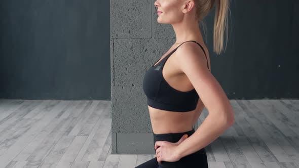 Portrait of Fitness Woman in Yoga Studio